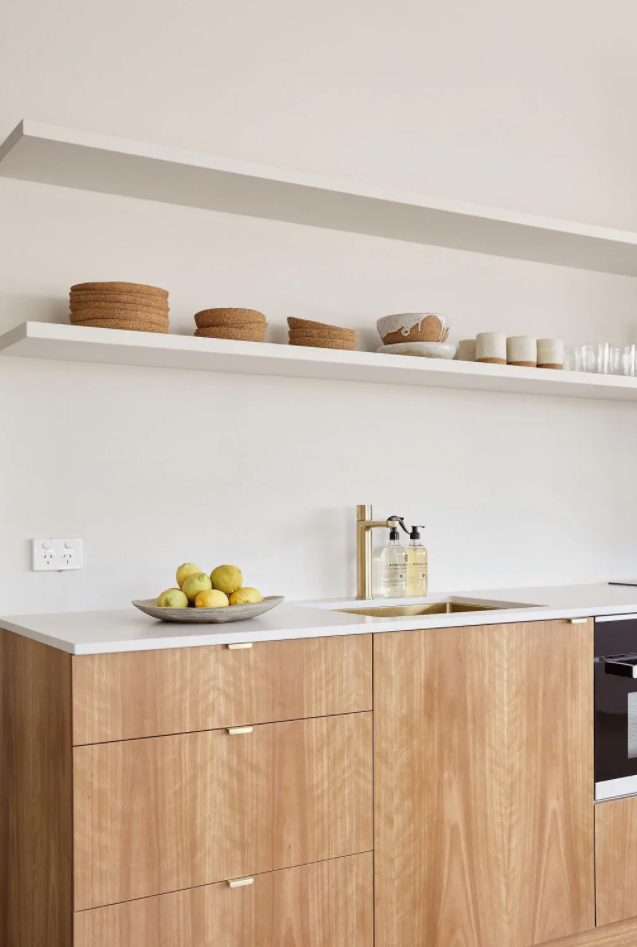 """Brass gold tap-ware gives this simple minimalist kitchenette a luxe look in [Apartamento Byron Bay](https://www.homestolove.com.au/st-agni-airbnb-byron-bay-21618