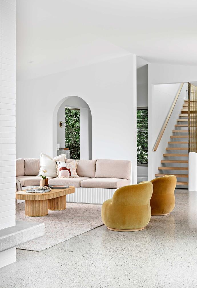 """**Living area** Tying in with the fluted furniture pieces nearby is the home's spectacular staircase, referred to by interior designer [Lee Talbot](https://www.mavenhome.com.au/
