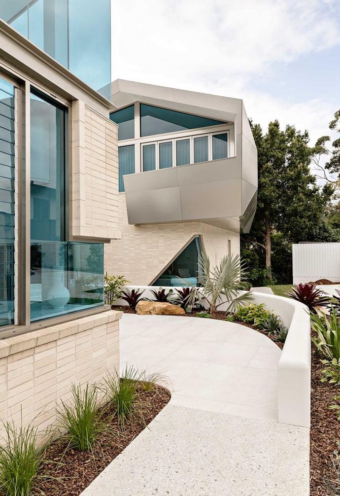 """**Facade** The external work included retaining walls and new anodised-aluminium cladding by [Smartfix](https://www.smartfix.com.au/