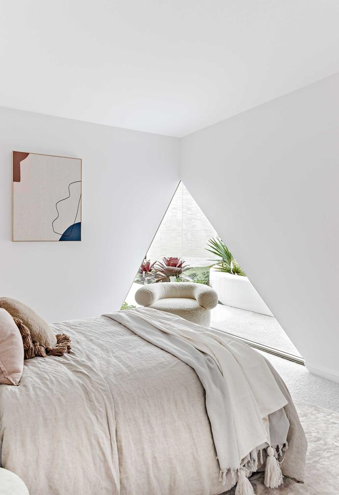 """**Guest room** The triangle shape of the cut-out window forms the perfect backdrop for the [Sarah Ellison](https://sarahellison.com.au/