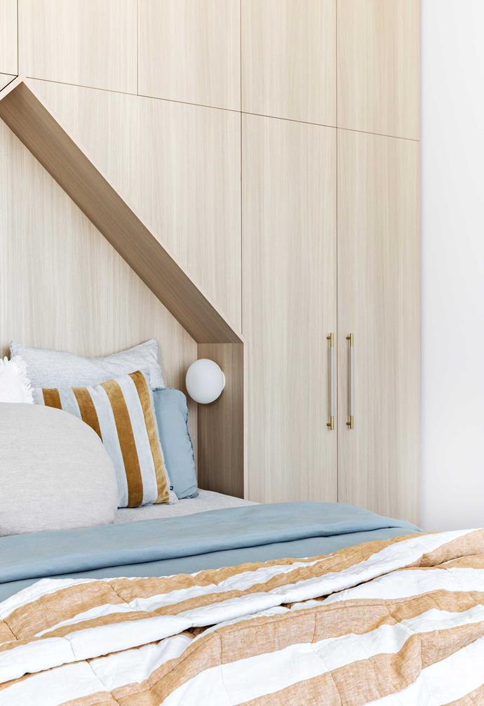 """**Bedroom** Custom Navurban joinery keeps everything out of sight in Ethan's room. Door handles, [MadeMeasure](https://www.mademeasure.com/