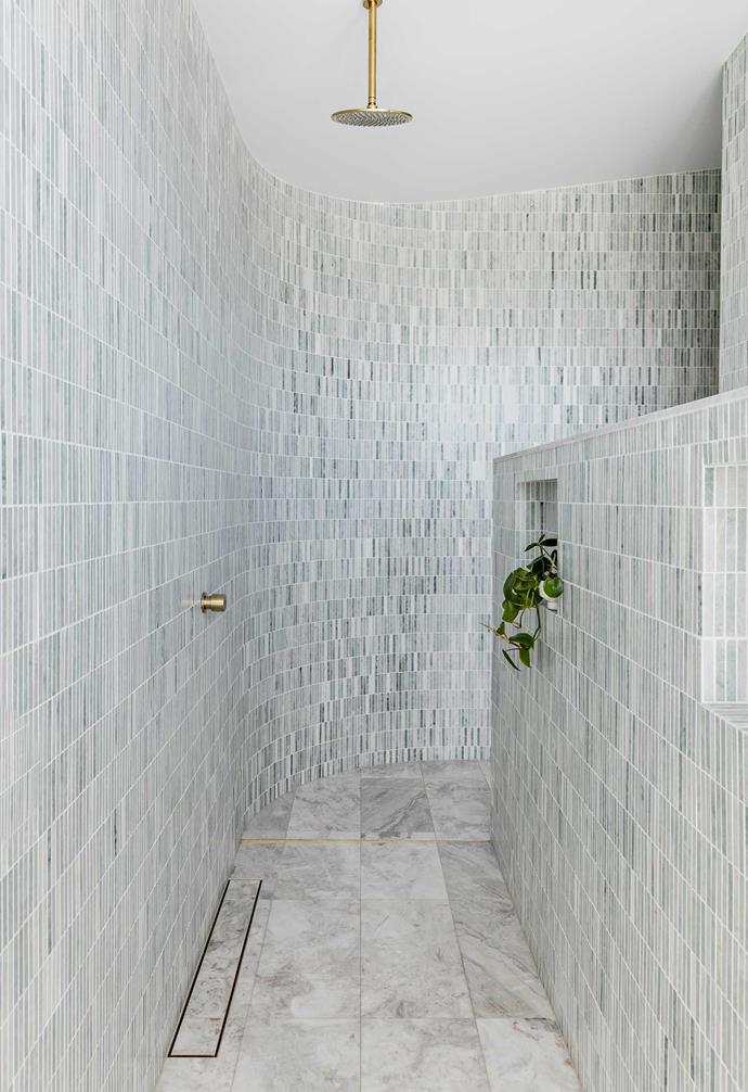 **Main ensuite** The curved wall gives a sense of journey to the double shower in the couple's top-floor bathroom. As in all the other wet areas, they've splurged on marble here.