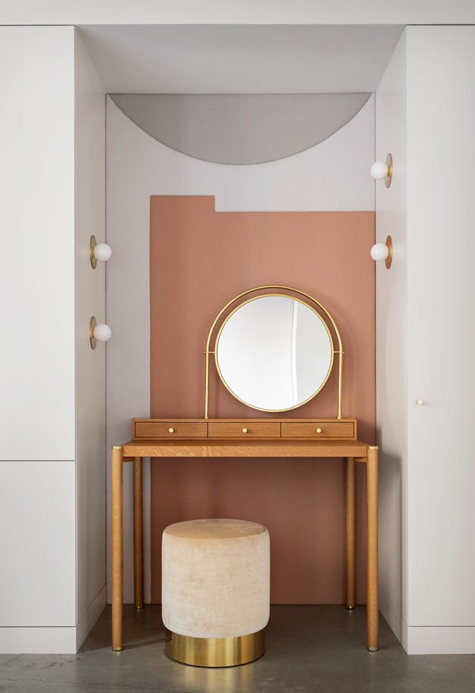 The make-up nook conjures Art Deco Hollywood glamour with its custom-made curved mirror, its Allied Maker spotlights and a cream ottoman Pam has owned for years. A padded wall made by Revive Upholstery softens the space.