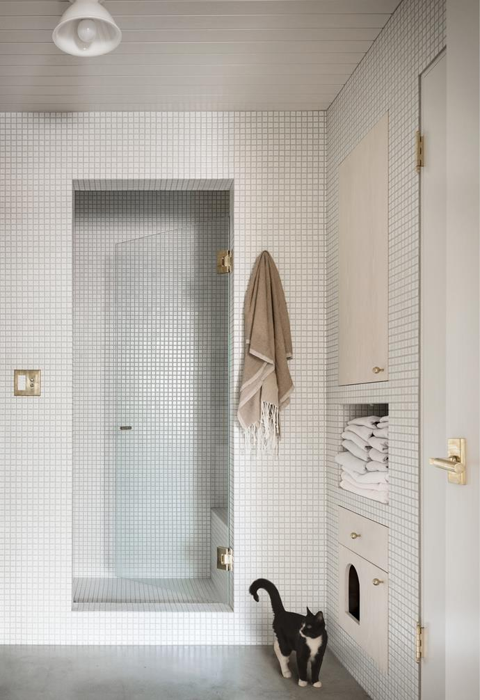 """""""I love the bitty one-by-one-inch Umi tiles from Design and Direct Source that we added in the bathroom and the kitchen,"""" Mira says. """"The tiler did an amazing job mitering the tiles at every outside corner. The end result is a visually quiet interior architectural element that provides a level of delight when you look closer and notice those mitered corners or the speckled pottery glaze."""""""