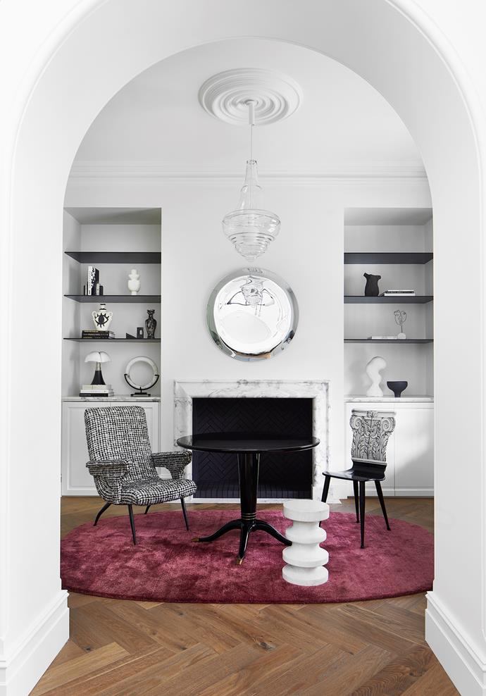 Vintage pieces in the study include a Fornasetti chair (on the right) and a mirror from 1stdibs. Rug from Cadrys. Lasvit Neverending Glory 'Prague Estate Theatre' pendant light from Living Edge.