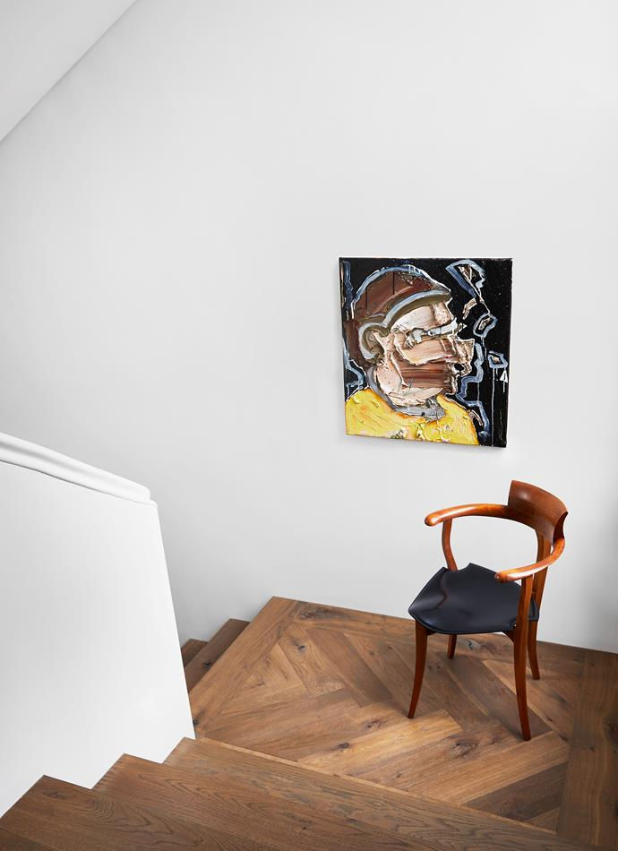 A painting by Toby Raine from James Makin Gallery guides you down the main home's stairs.