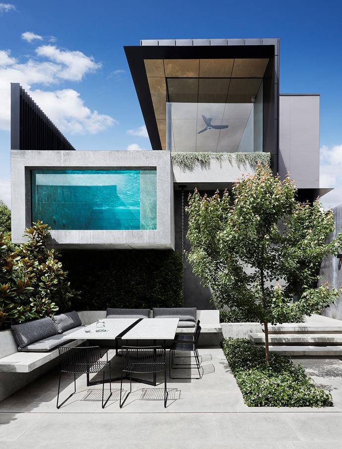 """""""The pool window provides a visual connection to the upper pool deck,"""" says architect Nicholas Murray of the pavilion separated from the main house by the courtyard. Terrazzo table from The Plutonic Furniture Company. 'Lerod' chairs from Stylecraft."""