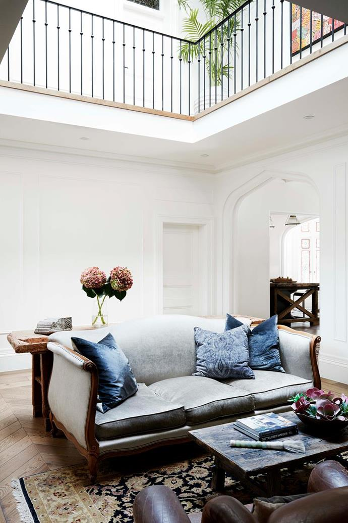 """The interior walls of this [grand Gothic revival home with Parisian inspired interiors](https://www.homestolove.com.au/gothic-revival-home-19307