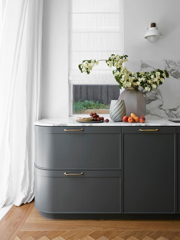 The kitchen joinery is by Adam Standfield Cabinet Making and hand-painted in Dulux 'Juvenile' with an Arabescato Vagli marble benchtop. Ceramics from Planet, Conley & Co and Manyara Home.