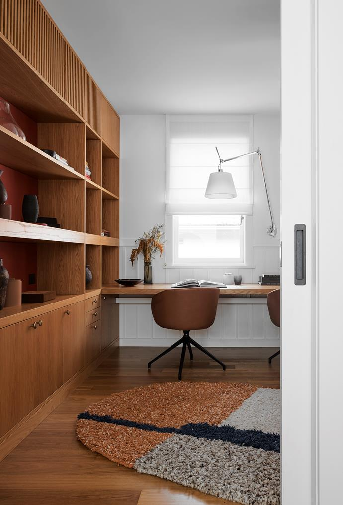 The study has joinery in American oak with wall upholstery in rust-coloured Kvadrat felt. Hay 'About a Chair' swivel chair in leather from Cult. Tolomeo wall light. Rug by Halcyon Lake.