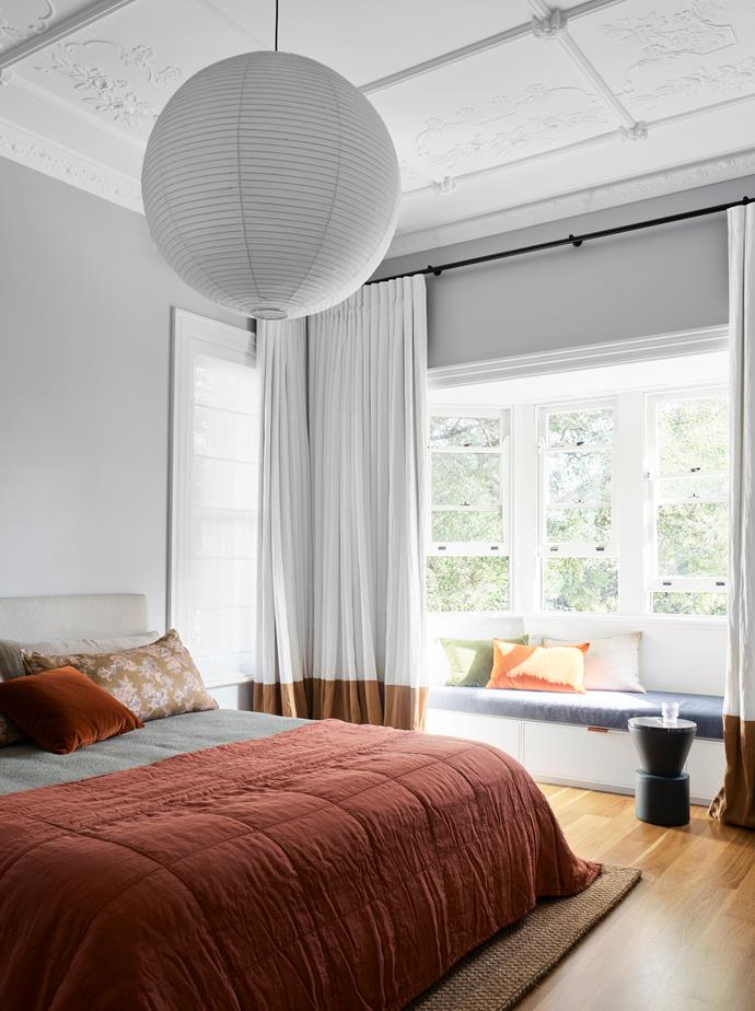 A custom bedhead and window seat by Arent&Pyke in the second bedroom. Cushions from Montmartre. Society Limonta bed linen from Ondene. Side table from Domo. Curtains by Simple Studio. Akari '75A' pendant light by Isamu Noguchi. Sisal rug from Natural Floorcoverings.
