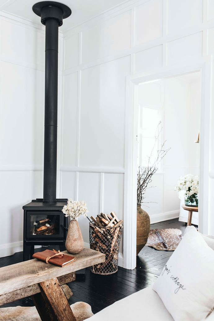 The wood fire and painted timber floors add to the home's character.