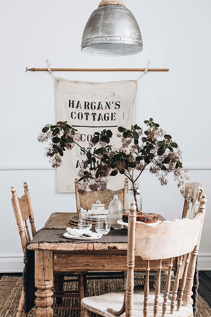 The printed wall-hanging was a handmade gift from a friend, while the rustic dining table and chairs are part of Belinda's collection of worn and weathered furniture finds.