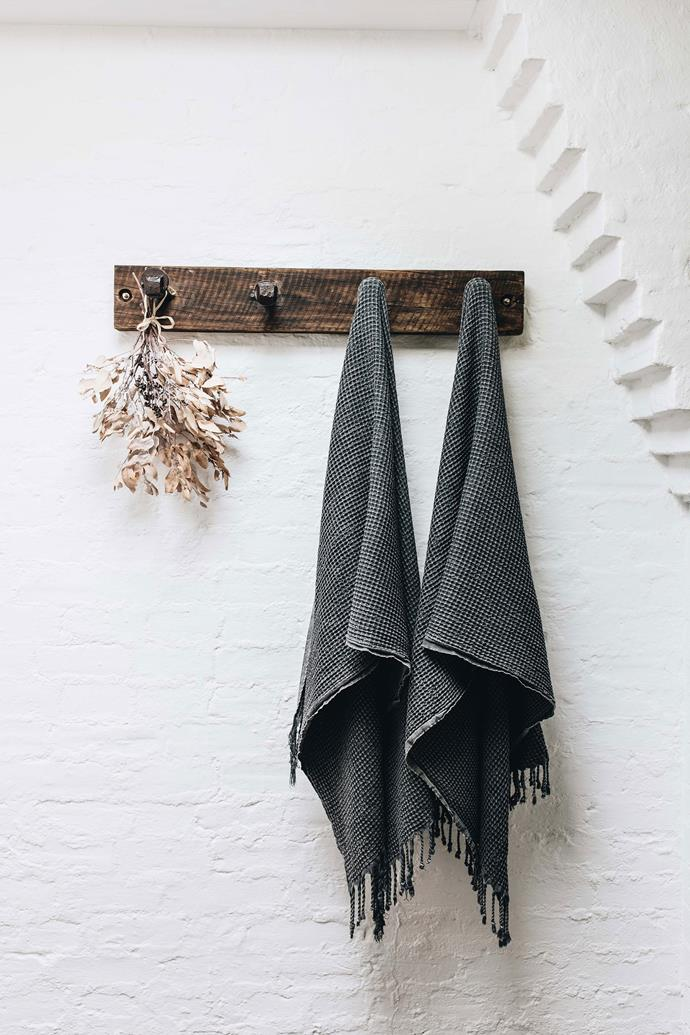 The rustic timber towel hooks were made by Stephen.