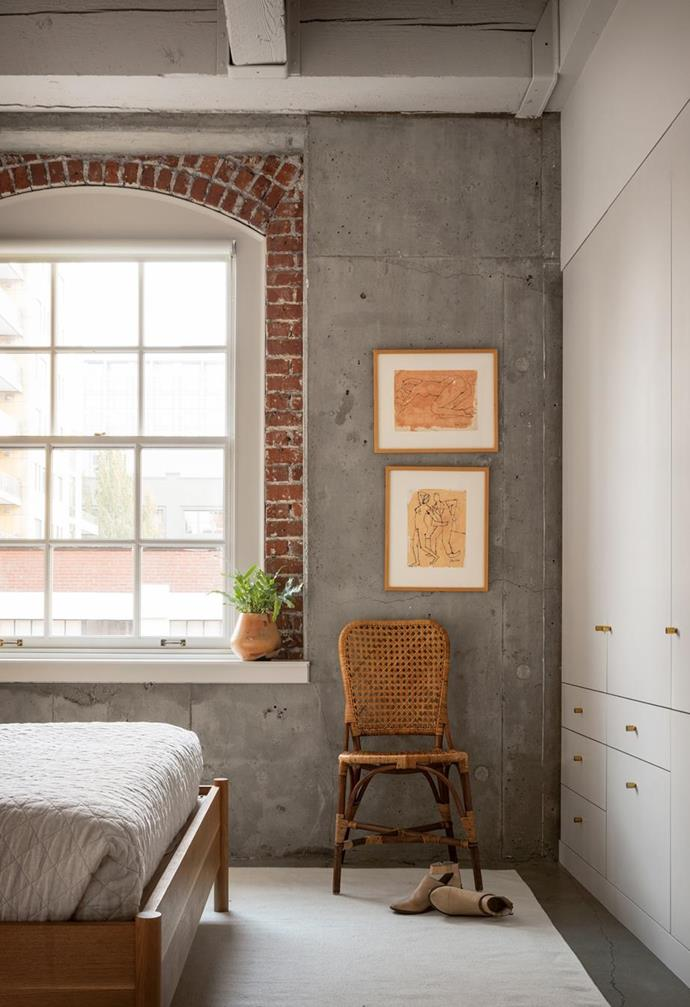 """A vintage chair, and exposed brick and concrete walls create a pared-back, relaxed look in this [serene loft apartment with an earthy palette](https://www.homestolove.com.au/chic-loft-apartment-portland-22529