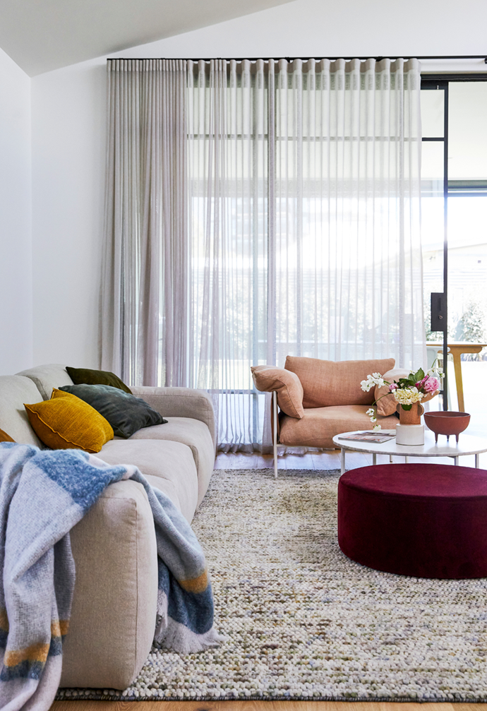 """Bright coloured cushions and furnishings paired with a neutral backdrop will create a contemporary interior that you can change around with seasons. Long curtains also bring a sense of luxury to the living room in this [romantic heritage cottage in south-east Melbourne](https://www.homestolove.com.au/heritage-white-cottage-modern-renovation-22356
