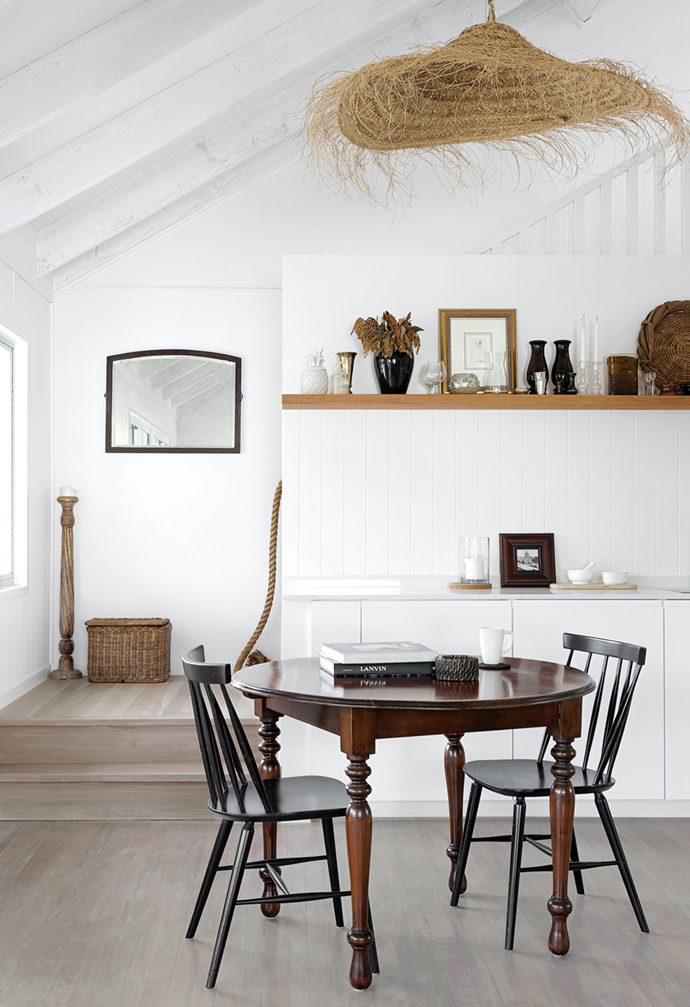 """Exposed ceiling beams painted in a fresh white bring character to the loft kitchenette and upstairs living space in this [Cape Cod-inspired beach house on the Sunshine Coast](https://www.homestolove.com.au/renovated-beach-house-sunshine-coast-22148