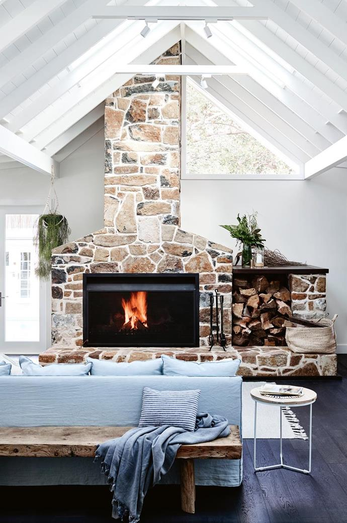 """The striking basalt fireplace in the living room of [SOUL of Gerringong](https://www.homestolove.com.au/coastal-farmhouse-reno-gerringong-18827
