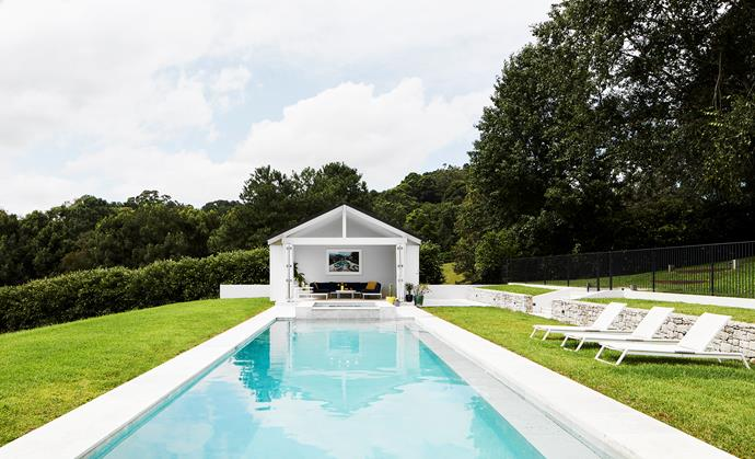 Studio George was also involved in the landscape design, which surrounds a 14-metre-long pool with Aren Bianco limestone coping by Onsite. Outdoor sofa, coffee table, bar trolley and 'Linear' sun lounges, all from Tait. Print by Slim Aarons from Cactus Hill Project.