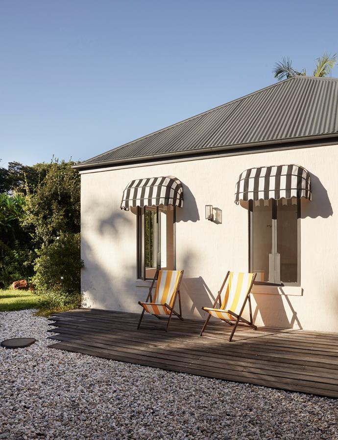 Window awnings from BlindDesign continue the stylish touches outside. Wall light from Lighting Collective. Deckchairs, client's own.