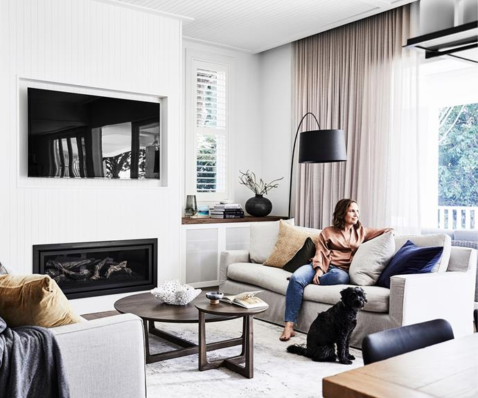 """The renovation produced a room full of pieces that continue the gentle tones. They include 'Scarlett' sofas and a 'Sky' coffee table from Fanuli and an 'Orion' rug from Designer Rugs, while a Foscarini 'Twiggy' lamp from Space lends sculptural appeal. Nerida chose VJ wall panelling in Dulux Whisper White to infuse the newer parts of the house with character. """"I tried to be consistent with all the details, so that it felt like an extension that complemented the older part of the house,"""" she says."""