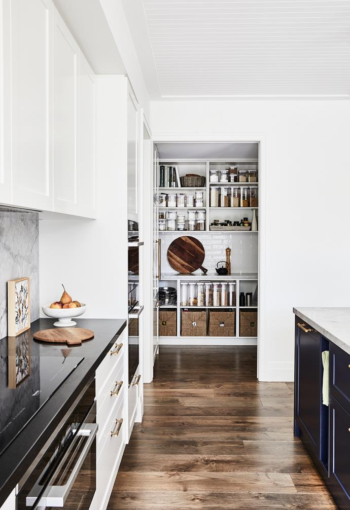 """A butler's pantry leads off the kitchen. """"I love how the grey tones of the benchtop contrast with the organic brass tapware and the indigo joinery."""" ~ Nerida"""