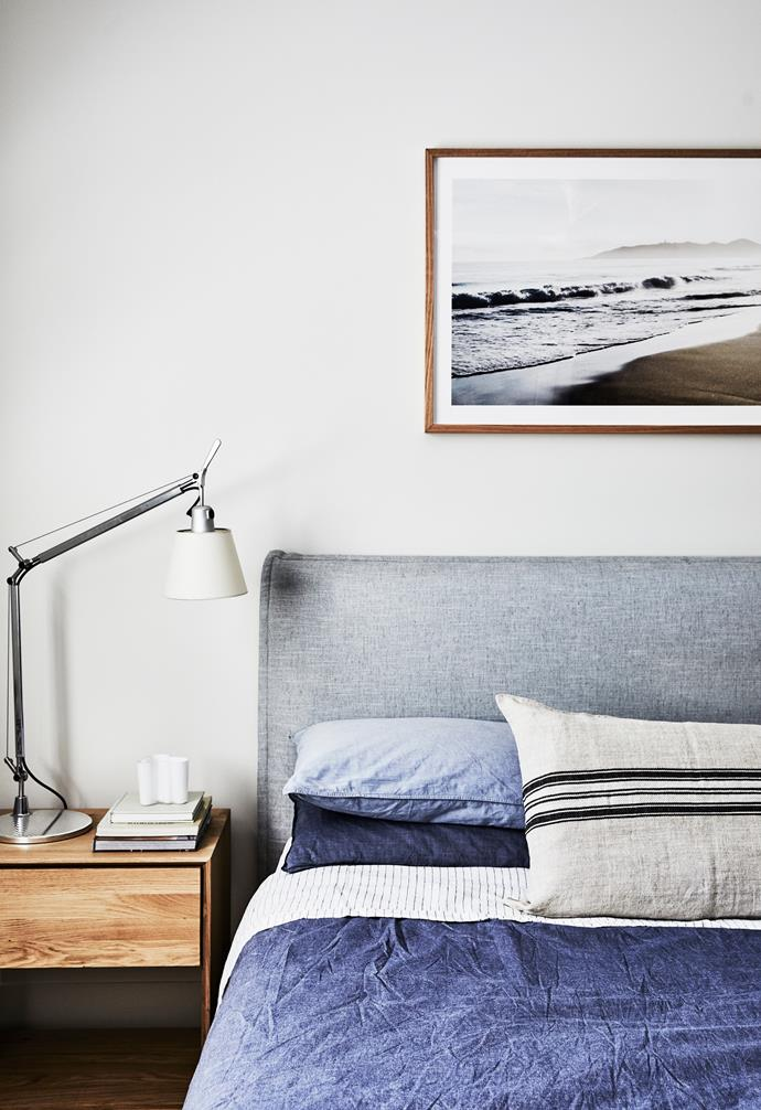 An Ethnicraft bedside table, In Bed linen and Camilla Q's 'Misty Morning Belongil' print are a stylish vignette in Hugo's room.