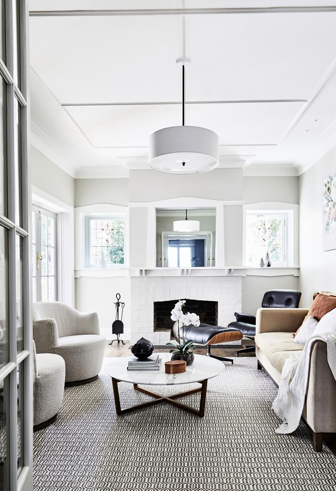 In the formal living area, pieces including a Jardan sofa, Eames lounge chair and matching ottoman from Living Edge and 'Milou Swivel' armchairs from Coco Republic lend a fresh feel. A rug from The Rug Collection anchors a restful scene that also includes a 'Fineline' coffee table from Spence & Lyda, a 'Reed' pendant light from The Montauk Lighting Co, cushions from Papaya and Provincial Home Living, and a Country Road throw.