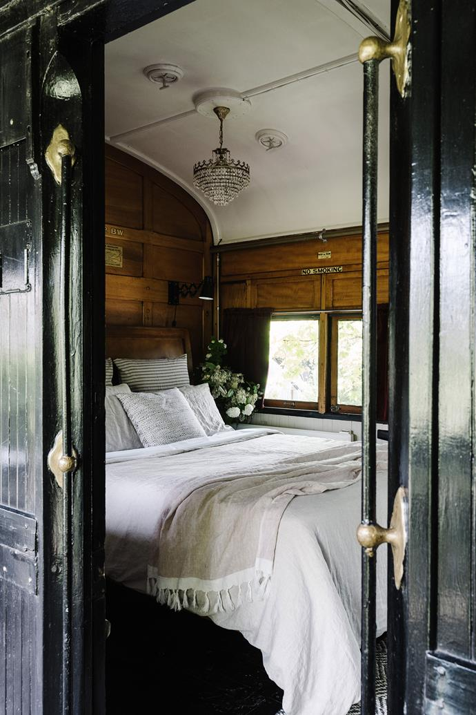 """This bedroom in a [converted steam train carriage](https://www.homestolove.com.au/train-carriage-accommodation-victoria-22543