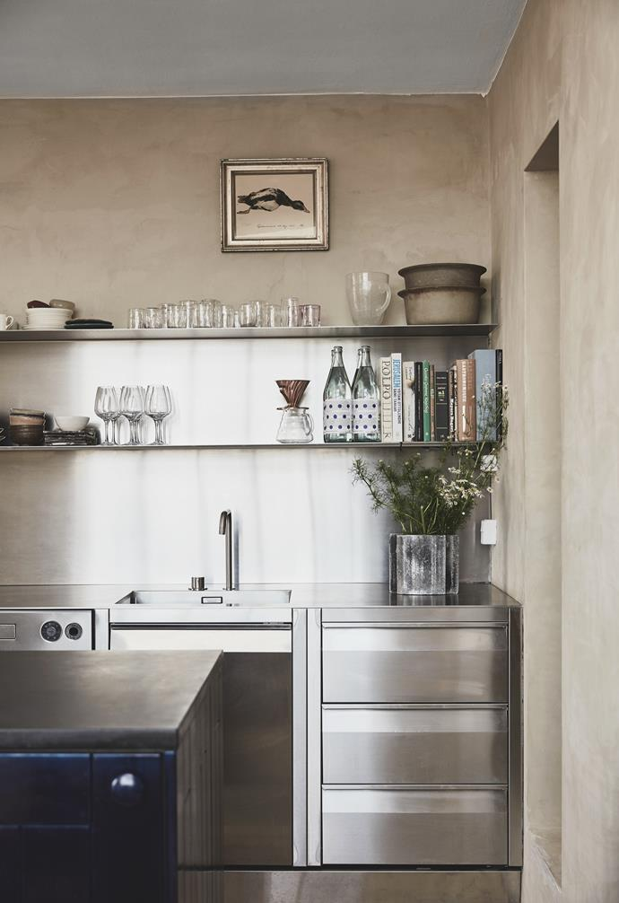 """""""We spend most of our time in the kitchen. Nikolaj designed it and he's always there,"""" says Malene. """"It's made to last, in industrial stainless steel."""""""