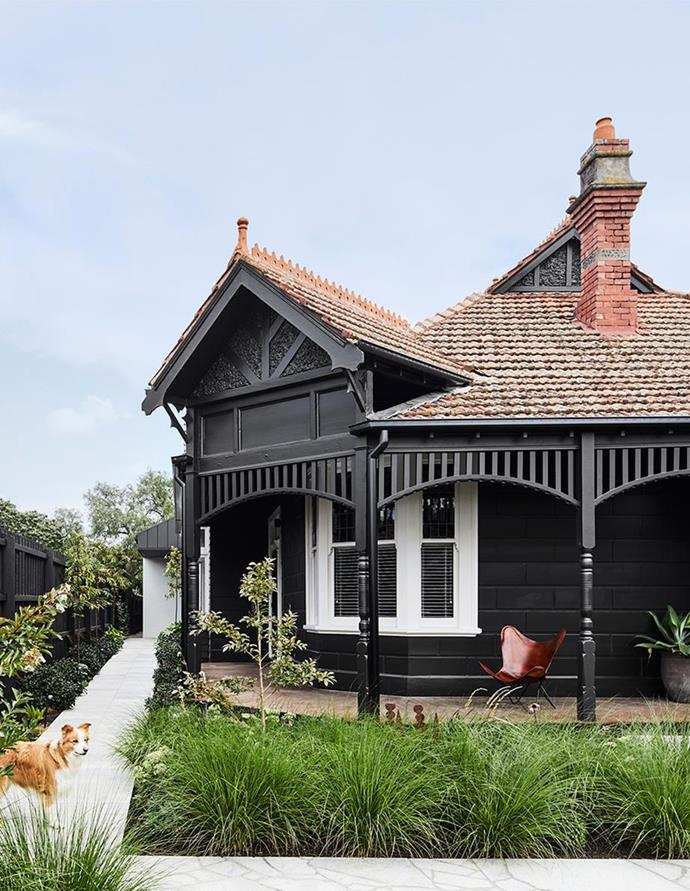 """The exterior of this [versatile Melbourne home](https://www.homestolove.com.au/heritage-house-striking-transformation-22515 target=""""_blank"""") was painted in a bold Resene Bokara Grey to make it a suitable gallery for the owner's paintings and sculptures."""