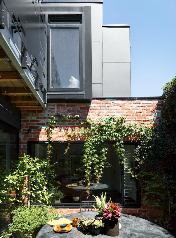 """What was a practically derelict [historic shop in Melbourne](https://www.homestolove.com.au/shop-turned-stylish-home-21322 target=""""_blank"""") was beautiful modernised as a home with a double storey in black built upon the brick remnants. The dark choice brought out the multi-hued colour in the old materials."""