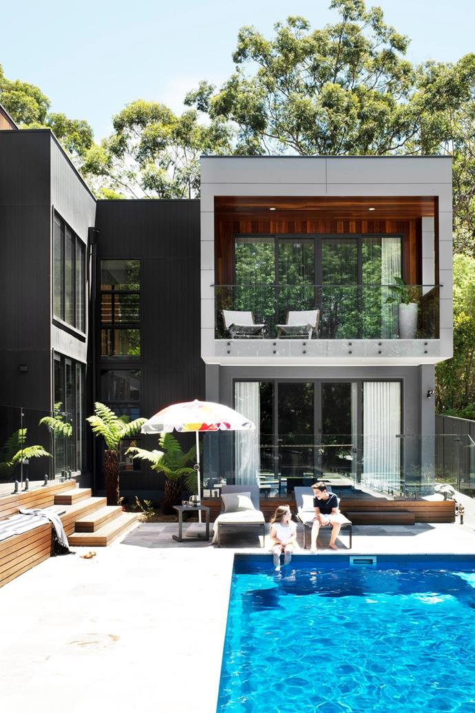 """Customised for a family of five, this spacious and sumptuous [new build south of Sydney](https://www.homestolove.com.au/spacious-new-build-south-sydney-21935 target=""""_blank"""") retains touches of the past and honours the colours and textures of its surrounding landscape with a dark exterior facade with touches of timber."""