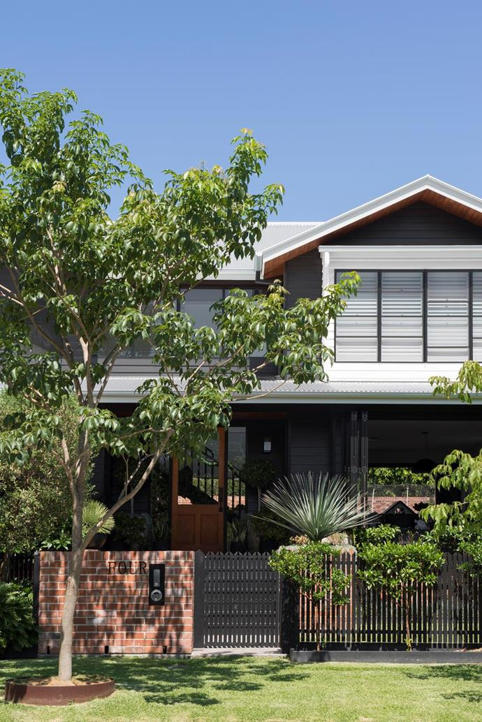 """The dark home exterior of this [modern new-build in Brisbane](https://www.homestolove.com.au/modern-new-build-brisbane-22028 target=""""_blank"""") is flanked by greenery and combines classic features with a modern feel for the best of both worlds."""