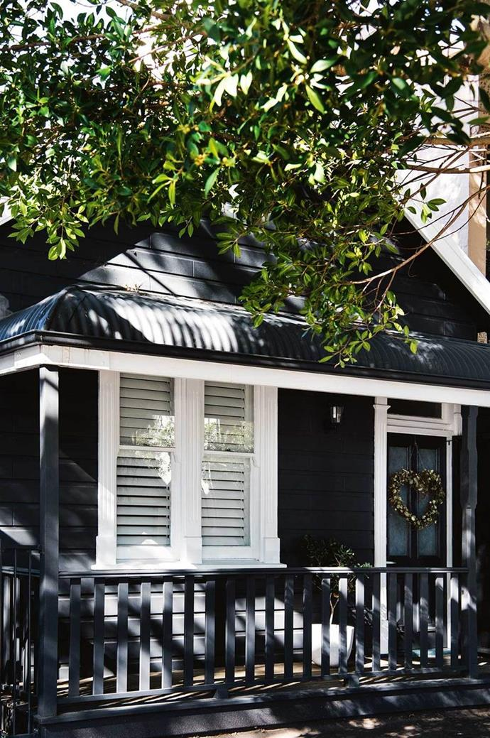 """This [Scandinavian-style shop and cabin](https://www.homestolove.com.au/seafront-scandinavian-home-newcastle-12266 target=""""_blank"""") sits on the coast of Newcastle, NSW, decked out to recreate the relaxed mood of a Nordic summer getaway. The home's exterior facade is painted in Dulux 'Domino'. """"I really wanted the house to be dark, which is similar to the little summer cottages you see on the lakes in Sweden,"""" says Libby."""