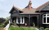 22 dark home exteriors that dare to be different
