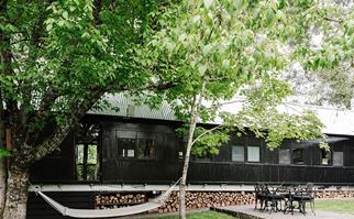 Converted train carriage accommodation painted in sleek black paint