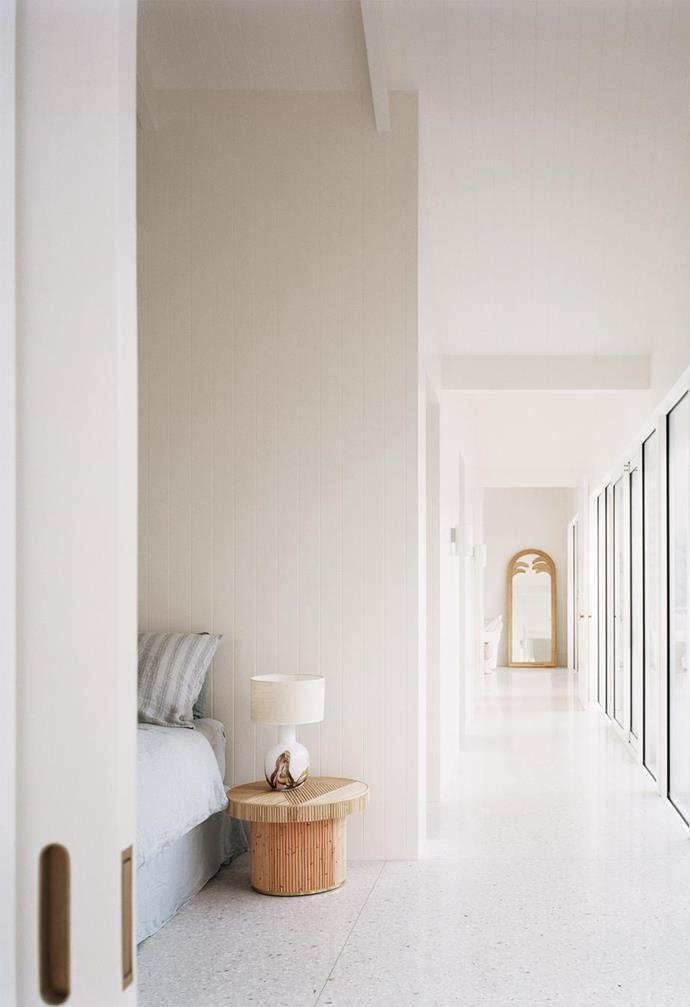 """Polished concrete floors, half-strength Dulux 'Berkshire White' wall paint and linen curtains set a neutral tone in this [serene minimalist beach house in Sorrento](https://www.homestolove.com.au/coastal-modern-minimal-home-sorrento-22203