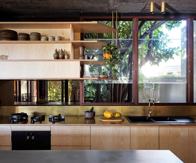 The kitchen is an exercise in restraint mixing plywood joinery, concrete benchtops and a hit of patinated brass as the surface under the window. Shelving is minimal and lean for the display of ceramics and everyday crockery. Gaggenau oven and Pitt cooktop.
