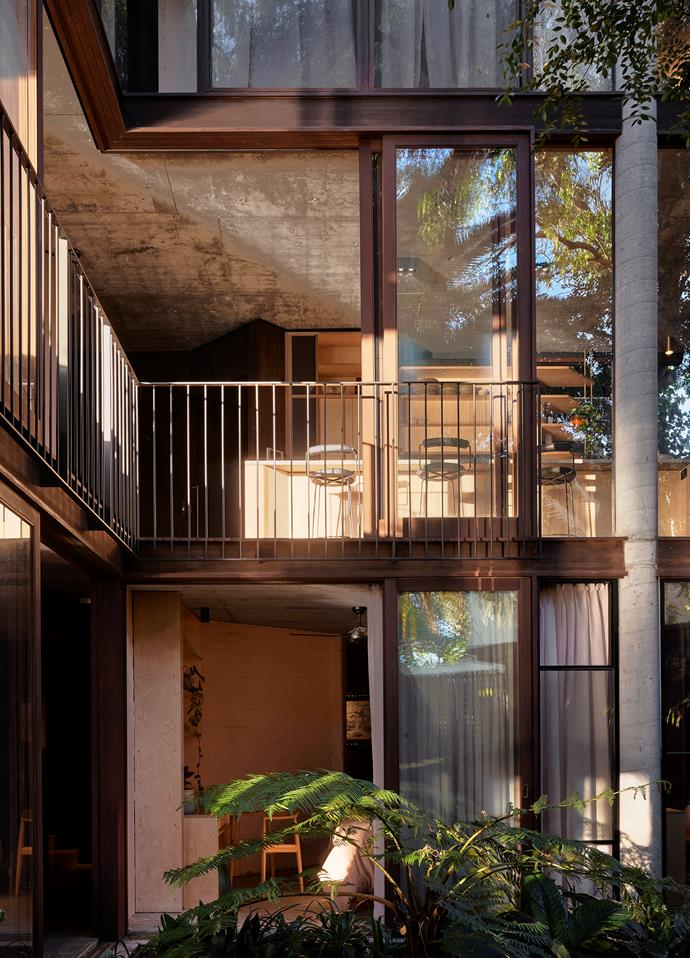 The strength of the geometry of the original design is evident looking up from the palm courtyard. Original concrete columns have been retained and the windows have been made operable with high-performance glass. The ground-floor bedroom once housed the heating and cooling system for the house