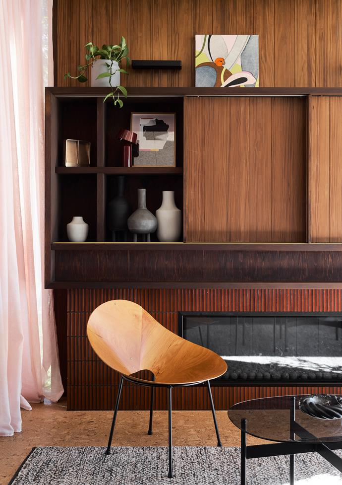The Japanese Inax 'Yuki' tiles from Artedomus in a deep red and the diaphanous pink curtain frame the Roger McLay 'Kone' chair from 506070. On the shelves, painting by Curtis Jere, 'Vide Poche' blackened bronze tray from Studio Henry Wilson and white pots from Papaya. 'Aesthetic' wall light from Est Lighting.