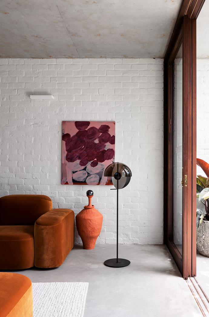The apartment terrace leads off the main living area. Artwork by Monique Lovering from Curatorial+Co.