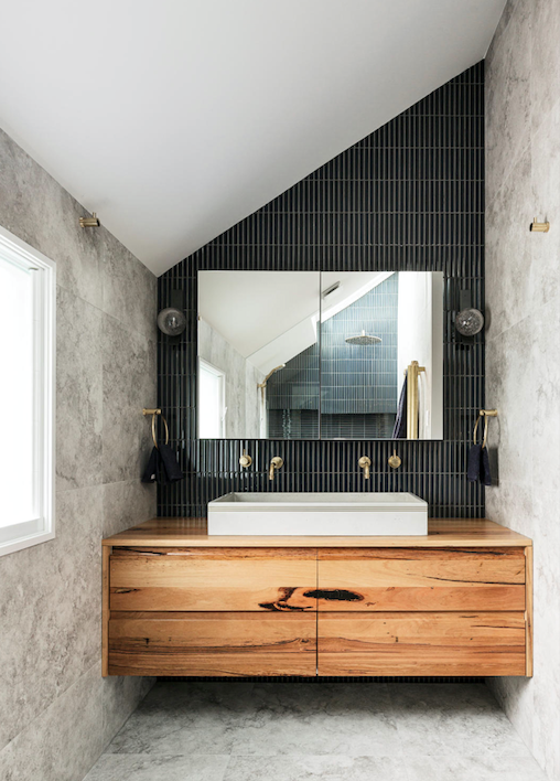 """Raku Cobalt finger mosaic tiles create a dramatic backdrop to the vanity and mirror in the bathroom of this [all-white cottage with a glamorous interior](https://www.homestolove.com.au/all-white-cottage-with-glamorous-interior-21343 target=""""_blank"""")."""