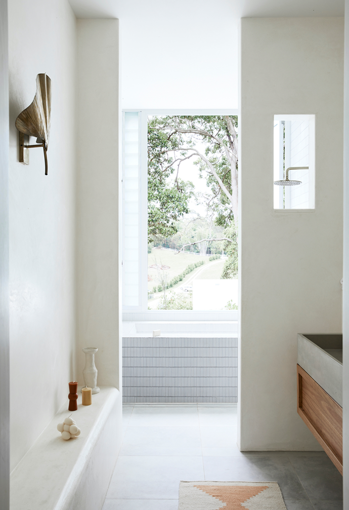 """A textural, neutral palette of mosaic finger tiles in the bathroom of this [sunlit new-build in Byron Bay](https://www.homestolove.com.au/new-build-byron-bay-hinterland-22186 target=""""_blank"""") ties in with the rest of the home and the view from the window."""