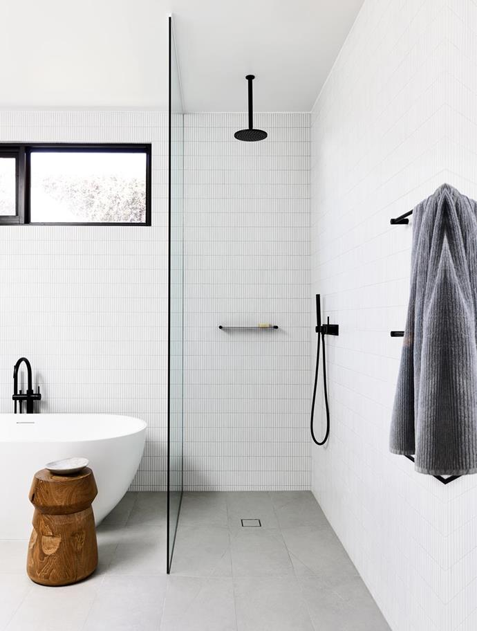 """Inax 'YB1' tiles from Artedomus add intricate detail and texture to this otherwise monochrome bathroom in a [Mornington Peninsula coastal property](https://www.homestolove.com.au/mornington-peninsula-home-by-planned-living-architects-5597 target=""""_blank"""") with an earthy palette."""