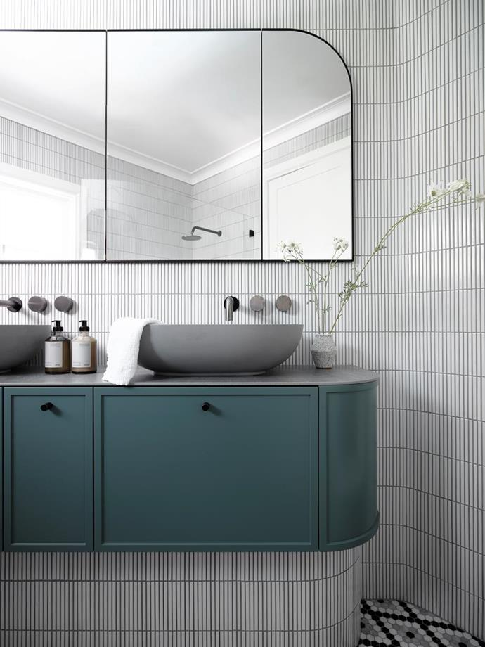 """'Bar Bianco' porcelain mosaic tiles from Di Lorenzo laid on the curved edges of the vanity and wall create intricate detail and depth in this [luxurious bathroom](https://www.homestolove.com.au/8-luxury-bathroom-design-ideas-to-inspire-5117 target=""""_blank"""")."""
