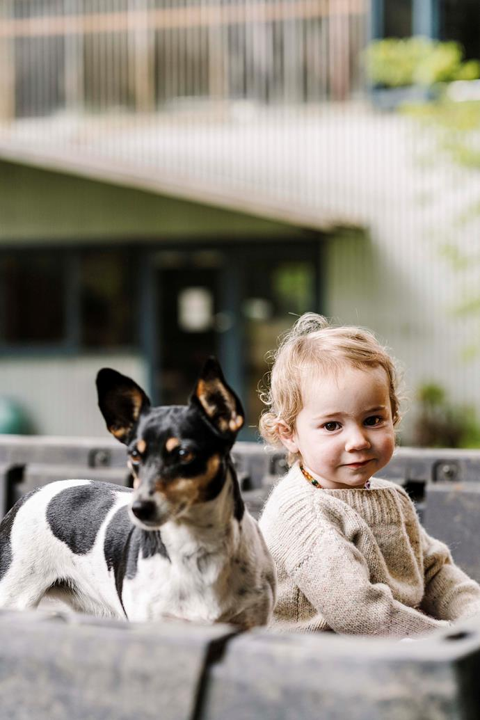 Granddaughter, Thora, with Strawberry the Jack Russell.