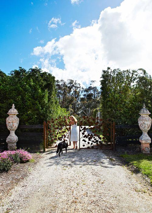 """A long driveway flanked by lush greenery leads the way to Catriona's country idyll. Wire gates crafted by Shades Of Gray display the Getaway presenter's signature """"practical but pretty"""" touch – """"They keep the children in, but are totally beautiful,"""" she says."""