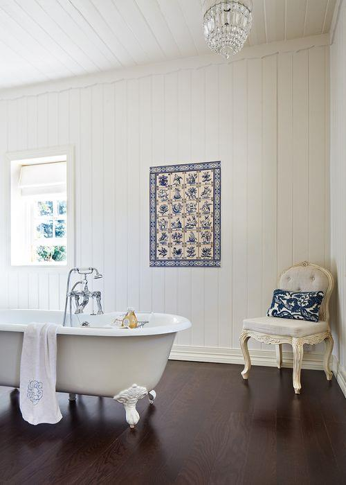 """A gorgeous clawfoot tub sets a tone of luxury. Catriona used a set of beautiful blue tiles she found in Obidos – """"the most romantic village in Portugal""""– to create exotic and unique wall art. """"I bought all the tiles I could physically carry and afford at the time,"""" she says. """"They only just squeezed into the plane's overhead locker!"""""""