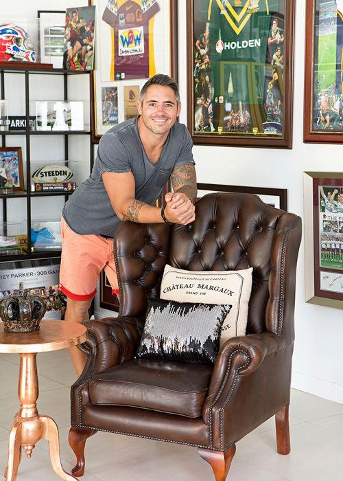 """""""We've come back to our roots,"""" says Corey. """"We both grew up not far from here, so we've sort of come full circle."""" His prized zone features a leather wingback chair that was found on Gumtree – for similar, try the 'Visitor' chair from Chesterfield Lounges – a copper side table and crown-shaped candleholder from European Design, plus, as you might expect, plenty of rugby league memorabilia."""